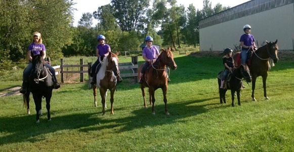 Michelle and group of teens learning to ride horses